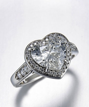 Other Rings 1-1: Heart shaped diamond surrounded by a bead set frame in platinum