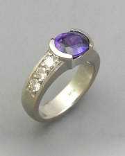 Other Rings 1-11: Oval purple sapphire in platinum with bead set diamonds down the sides