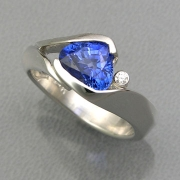 Other Rings 2-11: Triangular cut blue sapphire in a partial bezel set in white gold