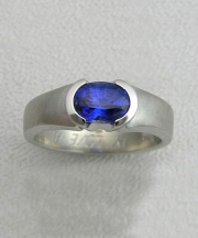 Other Rings 3-4: Oval blue sapphire partial bezel set in white gold