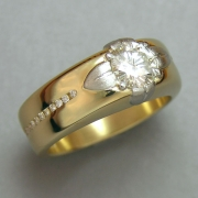Other Rings 1-12: Round cut diamond set in a platinum lotus flower with channel set diamonds down the sides in yellow gold