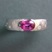 Other Rings 2-6: Oval pink sapphire partial bezel set with scattered diamonds on the sides in white gold