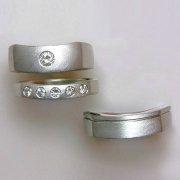 Bands 1-10: His and Hers engagement and wedding bands with round cut diamonds in platinum