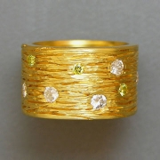 Bands 2-1: Wide textured band with round cut yellow and clear diamonds set in yellow gold