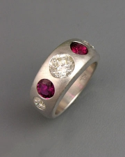 Bands 2-7: Round cut diamonds and rubies flush set in white gold