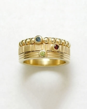 Bands 4-2: 14kt. yellow gold stacking rings with a sapphire, ruby and peridot