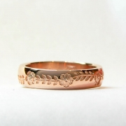 Bands 1-4: 14kt. rose gold custom band with flower and leaf motif