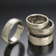 Damascus stainless steel grouping, slightly domed and flat band styles