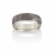 Damascus ring created from Limited ed. Circa 1870, Belgian made shotgun barrel cross section. 18k Yellow gold narrow rails and lining