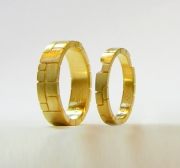 18kt. yellow gold custom matching bands with stone motif (two bands key into each other)