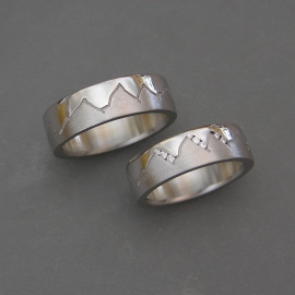 Pair of 14k White gold Misc Mountain bands with Diamonds channel set into Ladies version