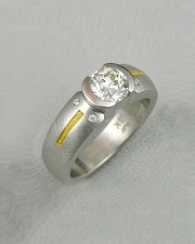 Engagement Ring 1-7: Round cut diamond in a 14k white gold partial bezel setting with 24k yellow gold inlay