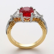 Engagement Ring 2-12: Round cut ruby prong set in platinum, and 18k yellow gold with triangular diamonds on the sides