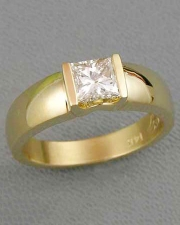 Engagement Ring 2-9: Princess cut diamond channel set in yellow gold