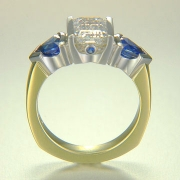 Engagement Ring 3-1: Emerald cut diamond channel set in platinum and 18k yellow gold with blue triangular sapphires on the sides