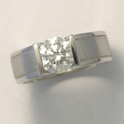Engagement Ring 3-4: Round cut diamond channel set in white gold