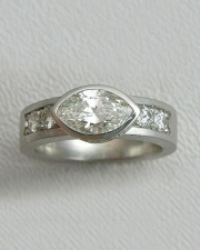 Engagement Ring 3-6: Marquise cut diamond full bezel set in white gold with bead set diamonds on the sides