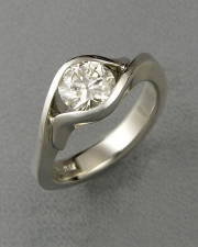 Engagement Ring 6-11: Round cut diamond partial bezel set in white gold