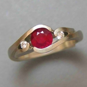 Engagement Ring 6-5: Round cut ruby partial bezel set in yellow gold with diamonds on the sides