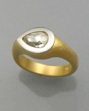 Engagement Ring 6-9: Pear cut diamond full bezel set in platinum and yellow gold
