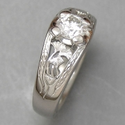 Engagement Ring 7-1: Round cut diamond prong set in white gold with gingko leaf detail