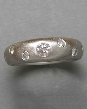 Engagement Ring 7-10: Several round cut diamonds flush set in white gold