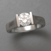 Engagement Ring 7-8: Round cut diamond channel set in white gold