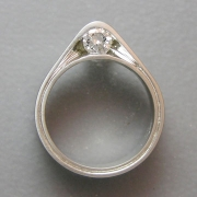 Engagement Ring 7-9: Round cut diamond partial bezel set on the side in platinum