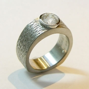 Engagement Ring 8-3: 14kt. white gold full bezel diamond engagement ring with heavy texture