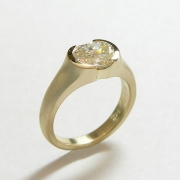 Engagement Ring 9-8: 14kt. yellow gold diamond engagement ring with partially bezel set Old Mine cut diamond
