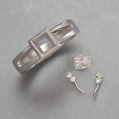 Platinum with a Princess Cut Center Diamond - Boulder Jewelry - Cronin Jewelers